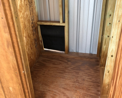 Inside of the back of a dog kennel