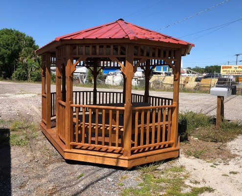 Light wood gazebo with red tin roof