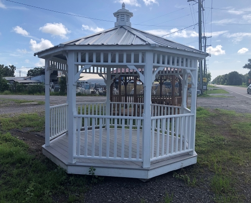 White wood gazebo with light grey tin roof