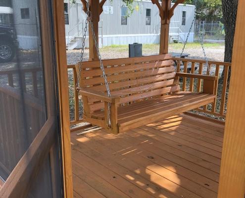 Wood hanging swing inside a gazebo