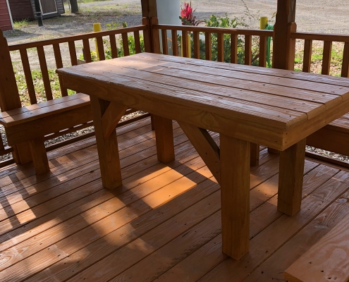 Wood table and benches inside a gazebo